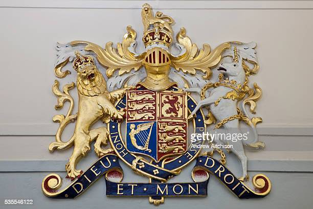 The Royal Coat of Arms that appears in all court rooms in England The official coat of arms of the British monarch
