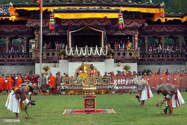 The Royal couple, King Jigme Khesar Namgyel Wangchuck and Queen Ashi Jetsun Pema Wangchuck watch as monks perform in front of thousands of Bhutanese...