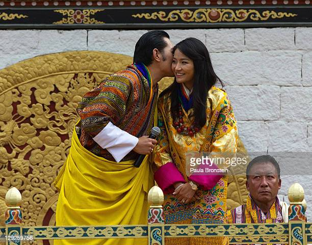 The Royal couple King Jigme Khesar Namgyel Wangchuck stands with his new bride Queen of Bhutan Ashi Jetsun Pema Wangchuck as they address a crowd of...