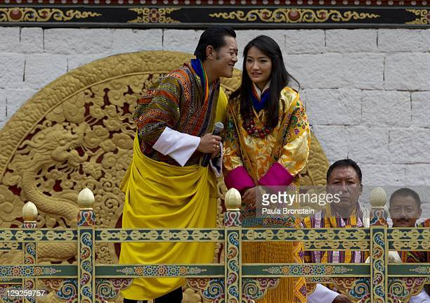 The Royal couple King Jigme Khesar Namgyel Wangchuck stands with his new bride, Queen of Bhutan Ashi Jetsun Pema Wangchuck as they address a crowd of...