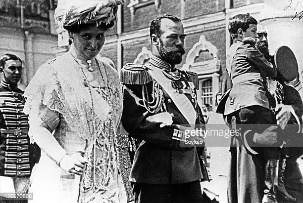 The royal couple of russia tsar nicholas ll and tsarina alexandra fyodorovna walking from the assumption cathedral to the nikolayevsky palace may 25...