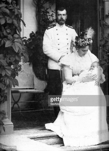 The royal couple of russia tsar nicholas ll and tsarina alexandra fyodorovna with child
