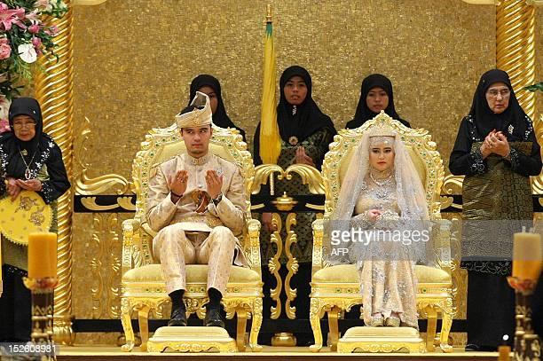 The Royal couple Princess Hajah Hafizah Sururul Bolkiah and her groom Pengiran Haji Muhammad Ruzaini prays at the end of the sittinginstate on royal...