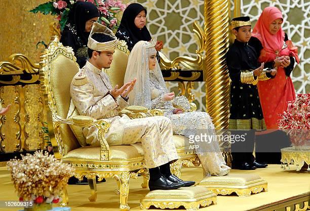 The Royal couple Princess Hajah Hafizah Sururul Bolkiah and her groom Pengiran Haji Muhammad Ruzaini prays at the end of the sitting-in-state on...