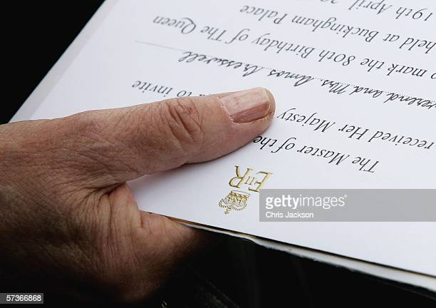 The Royal Crest is seen on an invitation as guests wait for their identification to be checked on April 19 2006 at Buckingham Palace in London...