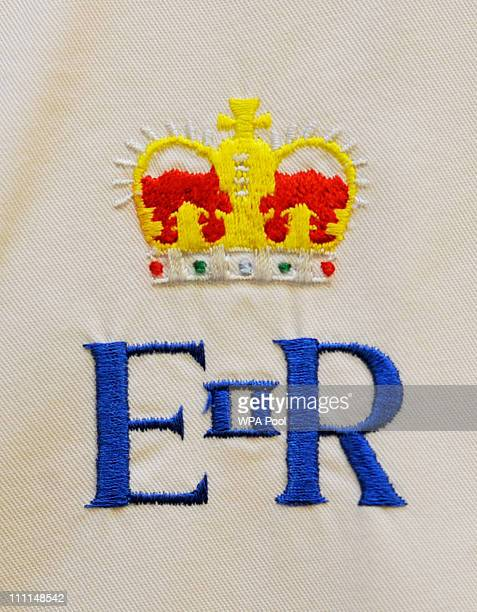 The Royal Crest on the chef whites of staff working in the kitchens is seen at Buckingham Palace on March 25 2011 in London England Prince Prince...