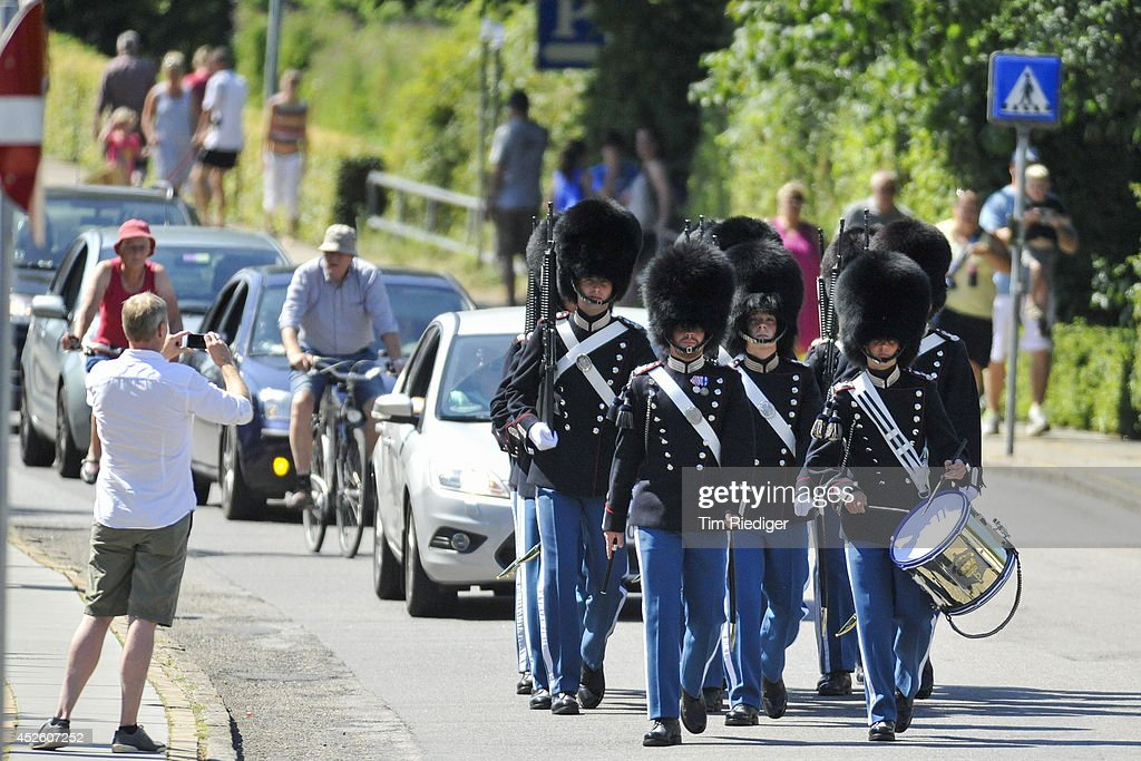 The Royal Danish Lifeguards march through the streets of Grasten in Denmark to the change of guards at Grasten Castle on July 24, 2014 in Grasten, Denmark.