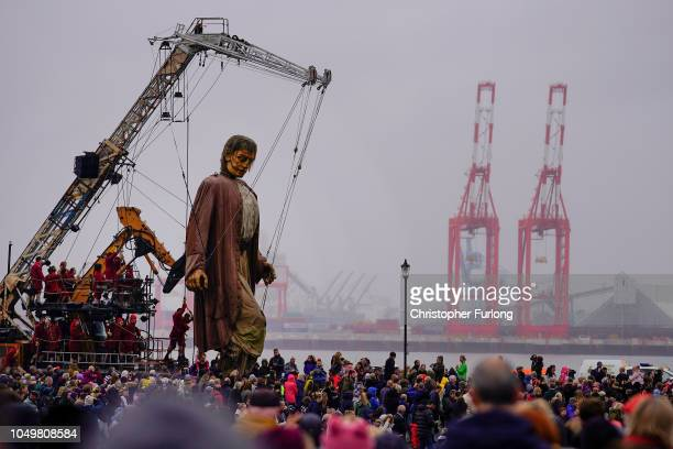 The Royal De Luxe's shipwrecked giant one of the worldfamous theatre company's street marionettes walks along the promenade at New Brighton as he...