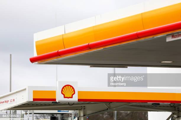 The Royal Dutch Shell Plc logo sits above the company's first UK hydrogen refueling station in Cobham UK on Wednesday Feb 22 2017 Shell crafting a...