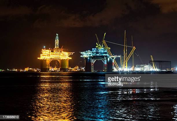The Royal Dutch Shell Plc Olympus tension leg platform is seen at night as it sets sail from Kiewit Offshore Services in Ingleside Texas US on...