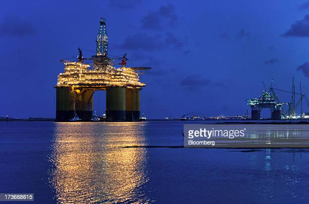 The Royal Dutch Shell Plc Olympus tension leg platform is seen at dawn as it sets sail from Kiewit Offshore Services in Ingleside Texas US on...