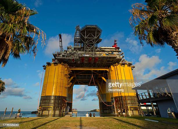 The Royal Dutch Shell Plc Olympus tension leg platform sails from Kiewit Offshore Services past homes in Ingleside Texas US on Saturday July 13 2013...