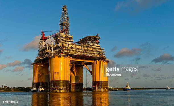 The Royal Dutch Shell Plc Olympus tension leg platform sets sail from Kiewit Offshore Services in Ingleside Texas US on Saturday July 13 2013 Olympus...