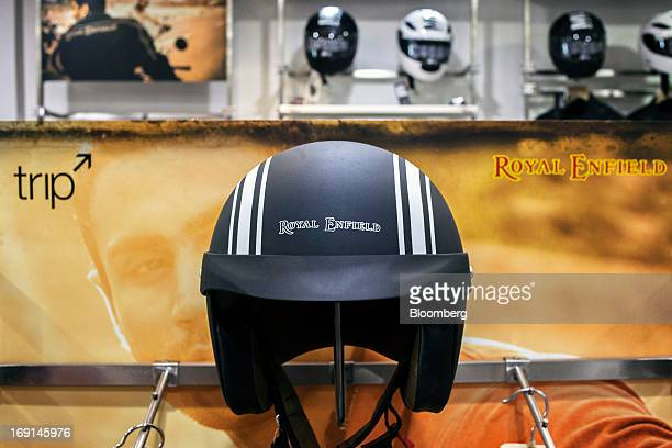The Royal Enfield logo is displayed on a motorcycle helmet on display at the Eicher Motors Ltd. Royal Enfield flagship dealership in Gurgaon, India,...