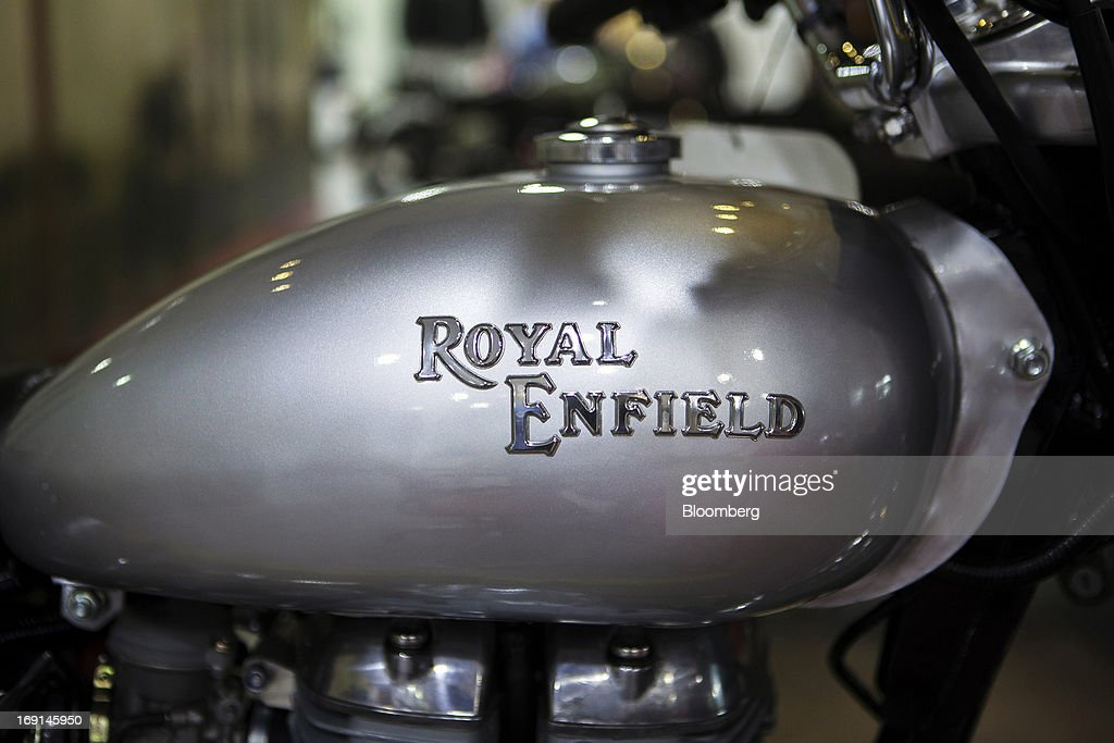 The Royal Enfield logo is displayed on the gas tank of a Bullet Electra motorcycle on display at the Eicher Motors Ltd Royal Enfield flagship...