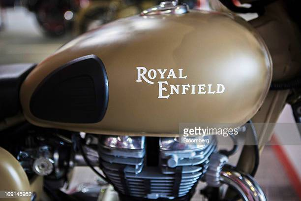 The Royal Enfield logo is displayed on the gas tank of a Desert Storm motorcycle on display at the Eicher Motors Ltd Royal Enfield flagship...
