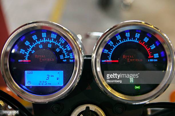 The Royal Enfield logo is displayed on the speedometer and rev counter of a Thunderbird motorcycle on display at the Eicher Motors Ltd. Royal Enfield...