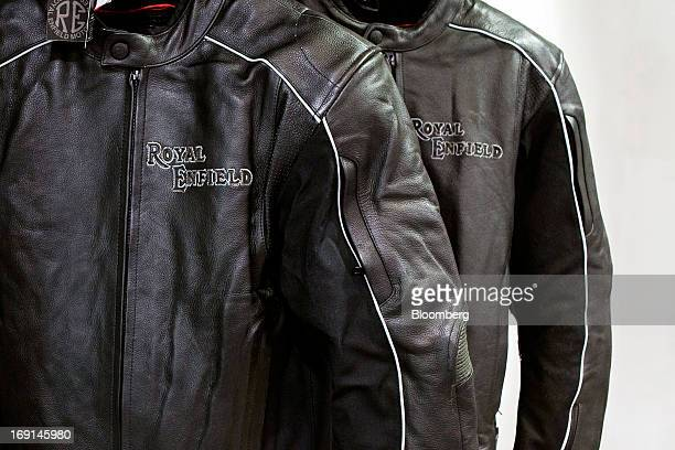 The Royal Enfield logo is imprinted on leather motorcycle jackets on display at the Eicher Motors Ltd. Royal Enfield flagship dealership in Gurgaon,...