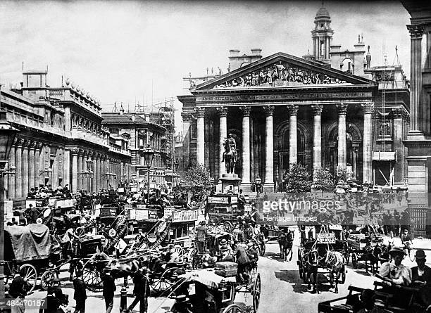 The Royal Exchange City of London c1900 The street in front of it is a mass of horse drawn carriages and buses Building work is taking place to the...