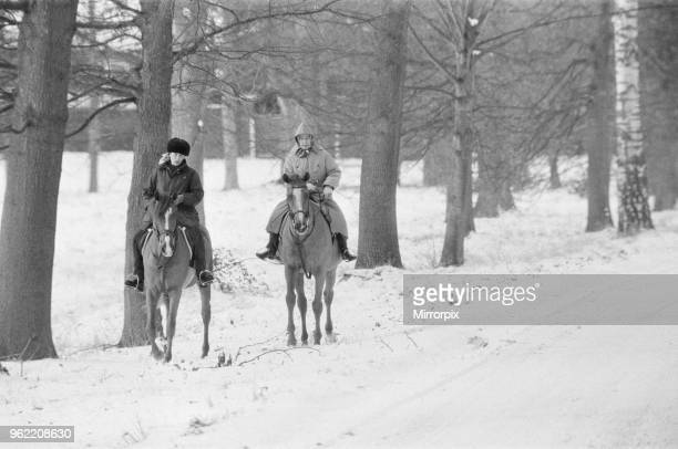 The Royal Family at Christmas and New Year Queen Elizabeth II and Princess Anne out riding their horses in the snow during their New Year holiday at...