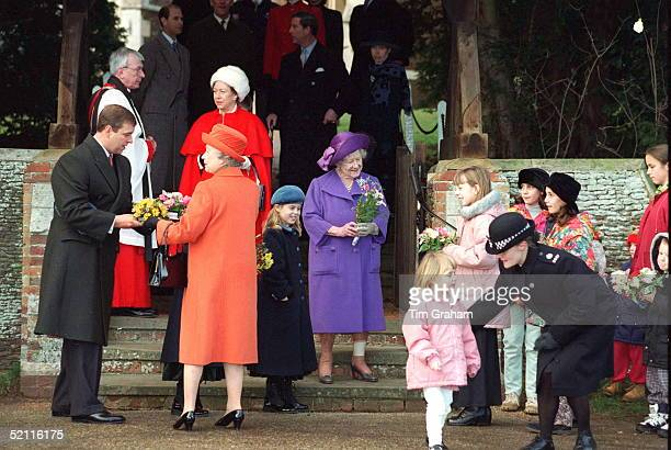 The Royal Family At Christmas Day At Sandringham - Prince Andrew Helps The Queen With Flowers. With Them Are Granddaughter Princess Beatrice,...