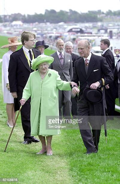 The Royal Family At The Epsom Derby Races. Prince Philip Helps The Queen Mother.