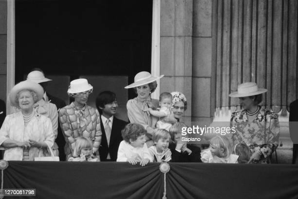 The royal family gather on the balcony of Buckingham Palace in London for the Trooping the Colour ceremony, 15th June 1985. Among them are Queen...