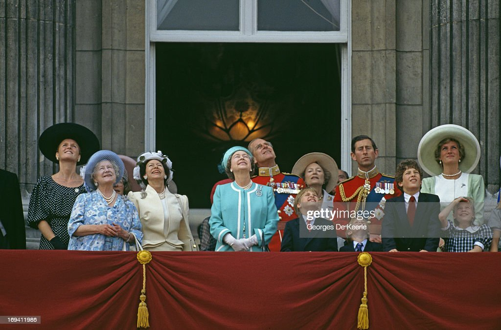 The Royal Family looking up to the sky from the balcony of Buckingham Palace during the Trooping The Colour Ceremony, The Queen's Official Birthday. (L To R) Duchess Of York, Queen Mother, Princess Margaret, Queen Elizabeth II, Prince Philip, Prince William, The Grand Duchess Josephine Charlotte Of Luxembourg, Prince Harry, Prince Charles, Lord Frederick Windsor, Princess Diana, Lady Rose Windsor, 16th June 1990.