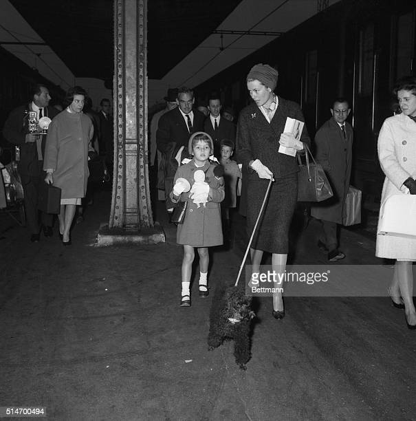 The royal family of Monaco walks through a train station in Paris They are resuming a vacation interrupted by a tax dispute with the French government