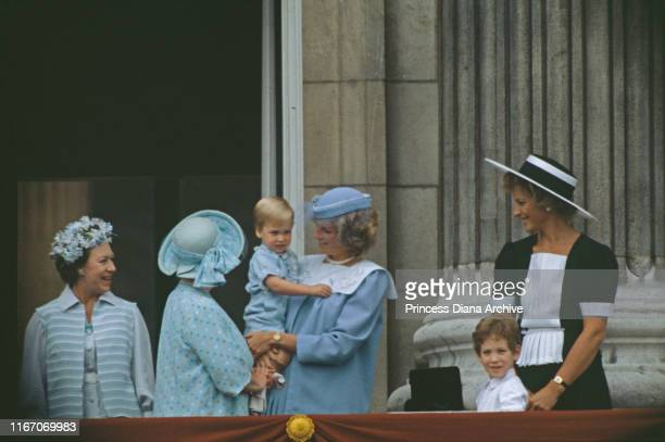 The royal family on the balcony of Buckingham Palace in London for the Trooping the Colour ceremony, June 1984. Diana, Princess of Wales is wearing a...