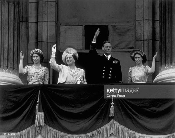 The Royal Family on the balcony of Buckingham Palace London waving to crowds gathered for VJ Day Princess Elizabeth Queen Elizabeth King George VI...
