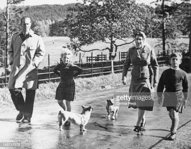 The royal family walking their corgis on the Balmoral Castle estate Aberdeenshire Scotland during a family holiday 18th September 1957 Left to right...