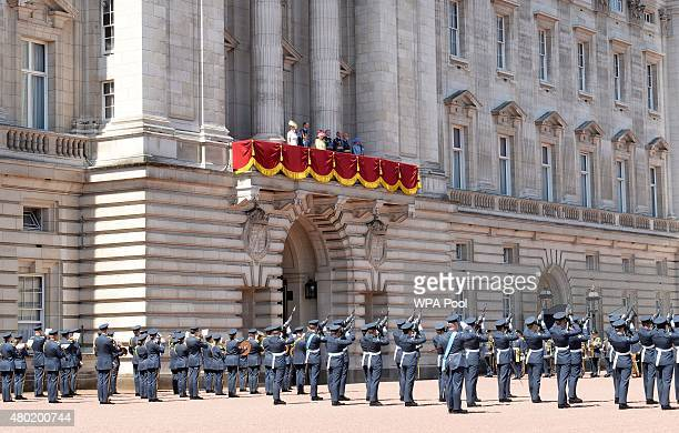The royal family watch a Feu de Joie given by the Old and New Guards found by The Queen's Colour Squadron Royal Air Force from the balcony of...