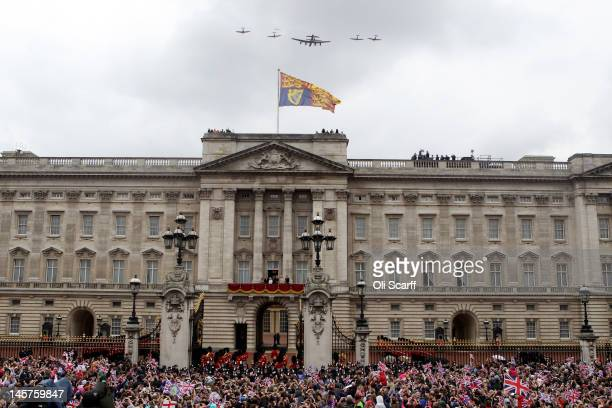 The Royal family watch from the balcony of Buckingham Palace as Lancaster Spitfire and Hurricane aircraft take part in a RAF fly past after the...