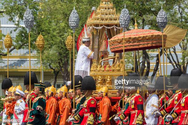 The royal funeral urn of the departed King Bhumibol Adulyadej is carried during the ceremony for moving the royal relics and royal funeral urn from...