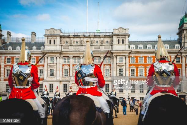 The Royal Guards in red uniform on horses, The Life Guards, Household Cavalry Mounted Regiment, parade ground Horse Guards Parade, Changing of the Guard, Old Admiralty Building, Whitehall, Westminster, London, England, United Kingdom