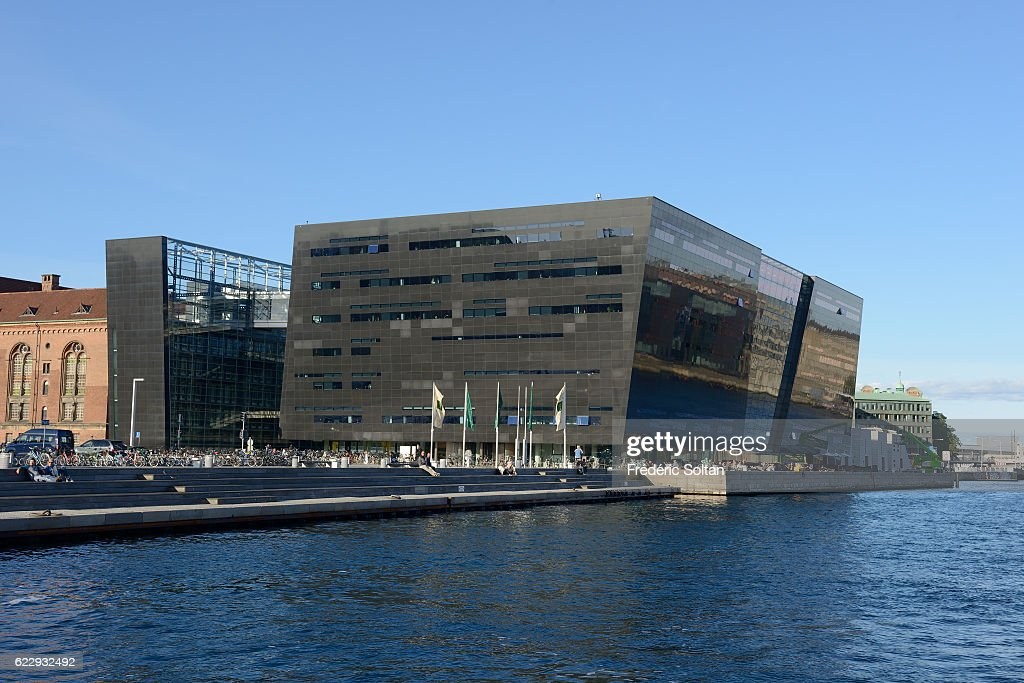 The Royal Library is also called 'the Black Diamond' along a Copenhagen canal - Denmark.