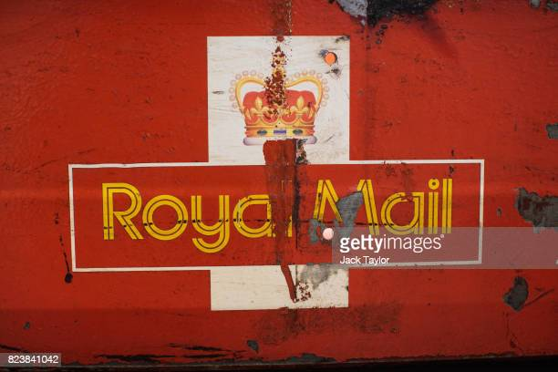 The Royal Mail logo sits on the side of a rail car from the 1980s on display at the Mail Rail exhibition on July 28 2017 in London England The Postal...