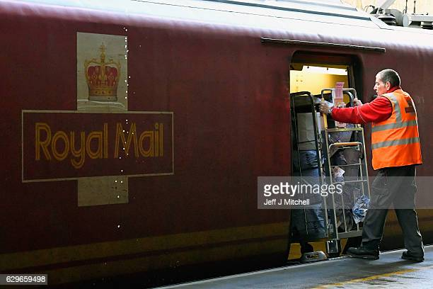 The Royal Mail train is loaded by workers at the Scottish Distribution Centre before travelling south on December 14 2016 in Wishaw Scotland In the...