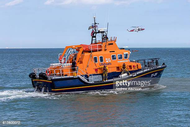 The Royal National Lifeboat Institution RNLI Dover Life boat HM Coastguard rescue helicopter and the RNLI Inshore lifeboat take part in a joint...