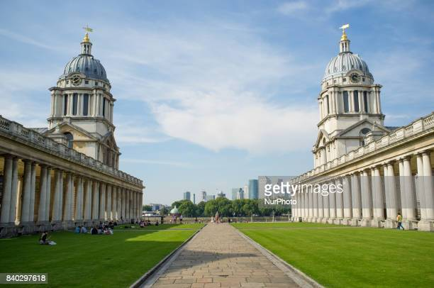 The Royal Naval College's towers are pictured against the backdrop of Canary Wharf's buildings London on August 28 2017 The August Bank Holiday has...