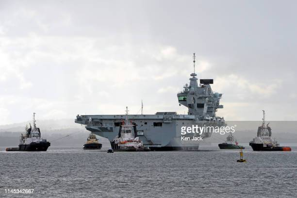 The Royal Navy aircraft carrier HMS Queen Elizabeth leaves Rosyth Dockyard where she was built after a period of planned maintenance on May 21 2019...