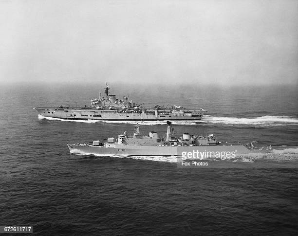 The Royal Navy Audaciousclass fleet aircraft carrier HMS Ark Royal during fleet exercises in the Mediterranean with the guided missle Countyclass...
