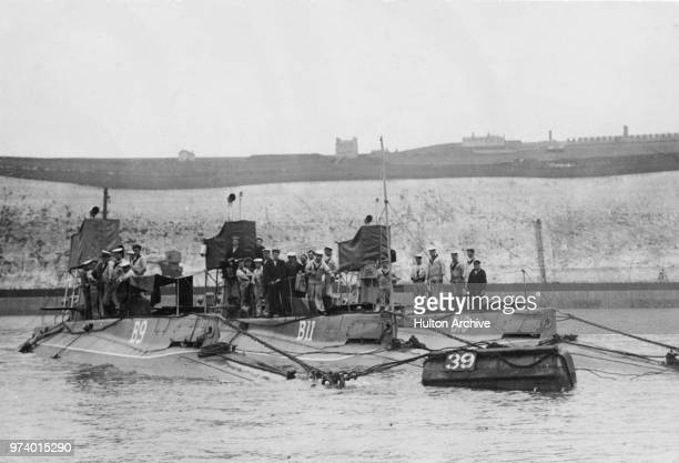 The Royal Navy Bclass submarines HMS B11 B10 and B9 with their crews on maneuvers in the English Channel off Dover prior to their transfer to the...