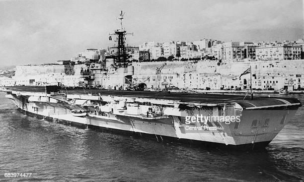The Royal Navy Centaur class light fleet aircraft carrier HMS Hermes steams into the Grand Harbour of the Port of Valetta naval base on 20 March 1967...