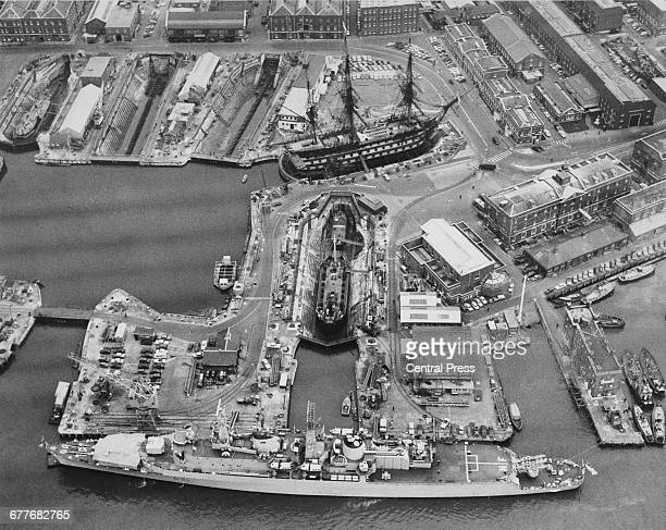 The Royal Navy Countyclass destroyer HMS Norfolk is seen from the air lying up in the Portsmouth dockyard near the18th century 104gun firstrate ship...