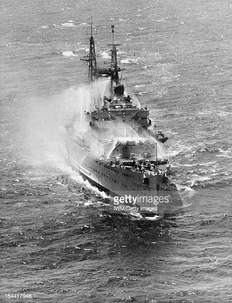 The Royal Navy During The Cold War 19451991 Trials ship HMS CUMBERLAND initiates her 'Prewetting' system during testing in the Mediterranean...