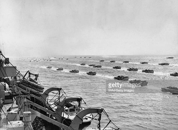 The Royal Navy During The Second World War A fleet of Landing Craft Assault passing a landing ship during exercises prior to the invasion of Normandy...