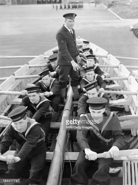 The Royal Navy During The Second World War At HMS RALEIGH the naval training base at Torpoint Cornwall new recruits to the Navy learn to pull a boat...