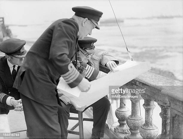 The Royal Navy During The Second World War Captain H Hickling DSO RN NOIC Arromanches going over a plan of Mulberry 'B' with Winston Churchill on the...